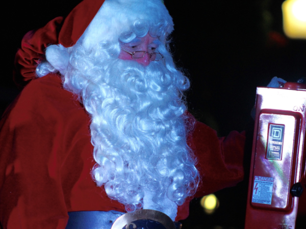 Santa flips on the switch and Lights up Plant City and the Lights of Love Tree