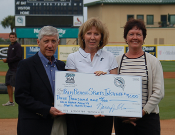 Accepting the check at Roger Dean Stadium, from left to right; Gerry Baron Executive Director of the PBCSC, Nancy  Olson Executive Director of the FMCF and Patty Dent President of the PBCSC.