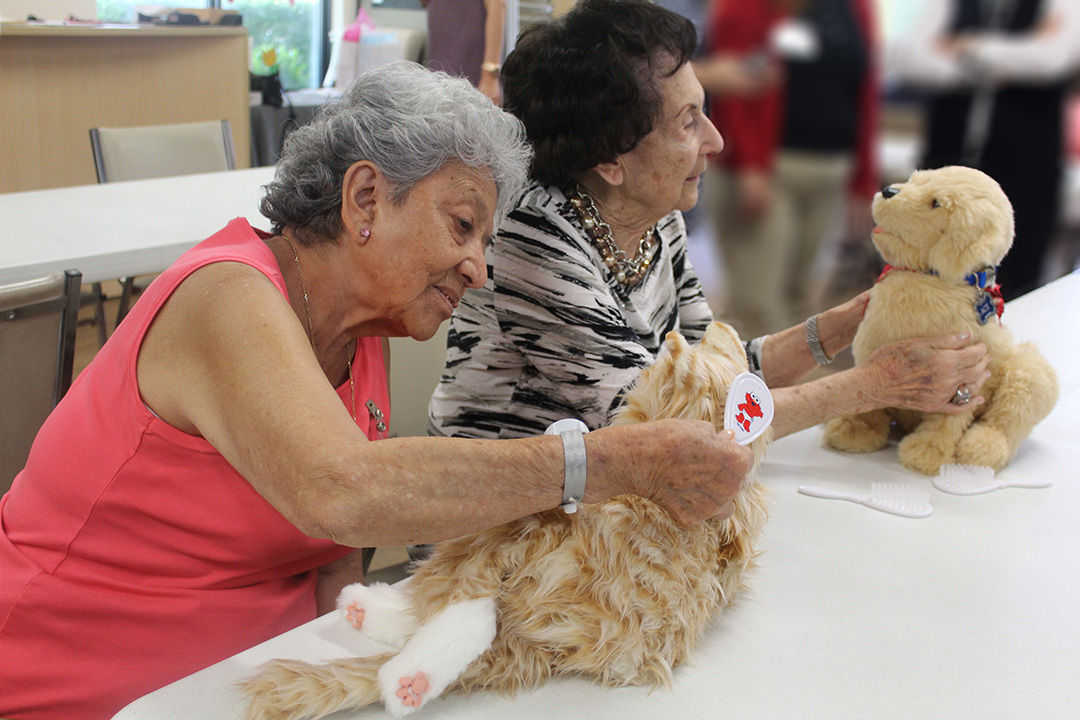 Patients at Alzheimer's Community Care with Therapeutic Robotic Pets