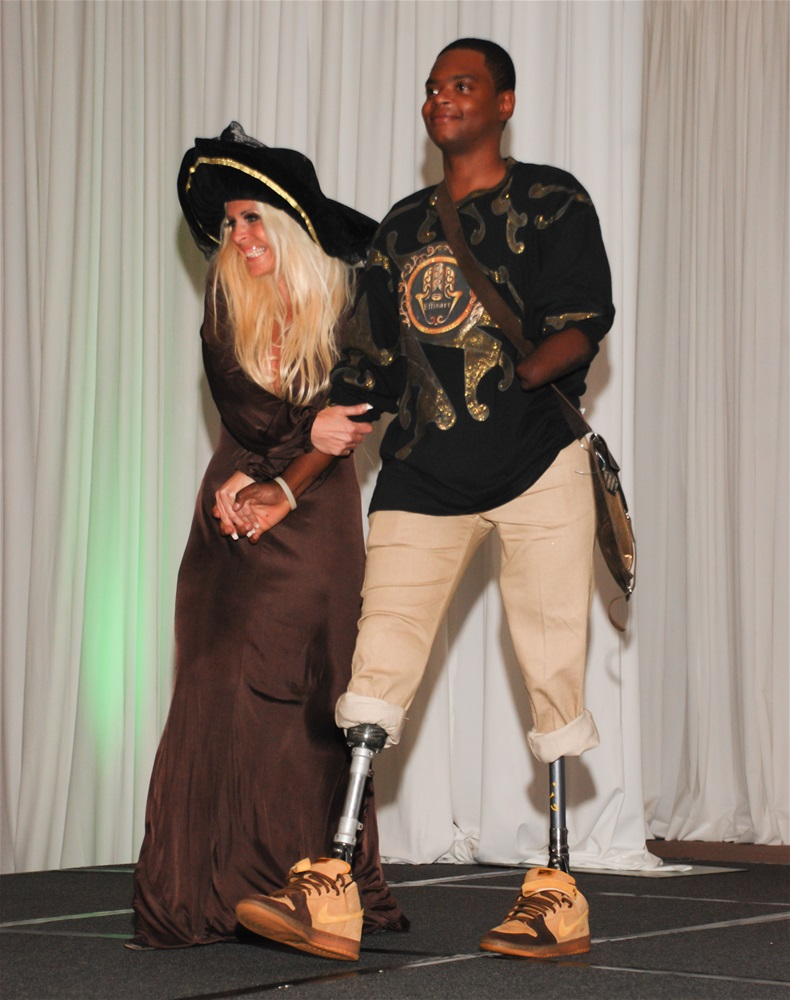 Designer Elfie and male model in casual outfit showing artificial limbs