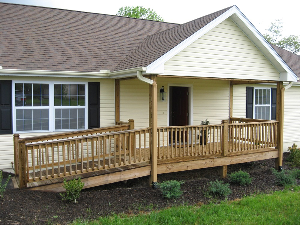 A single family home with wood ramp at front entry