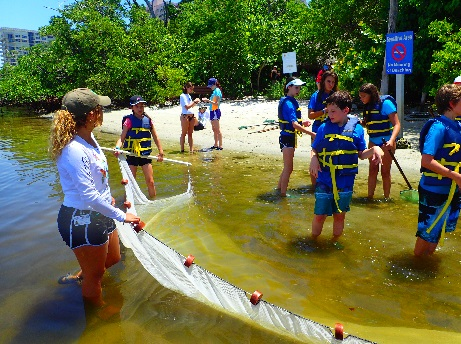 CIT volunteer seining with campers