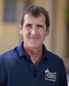 Man wearing a blue polo shirt.